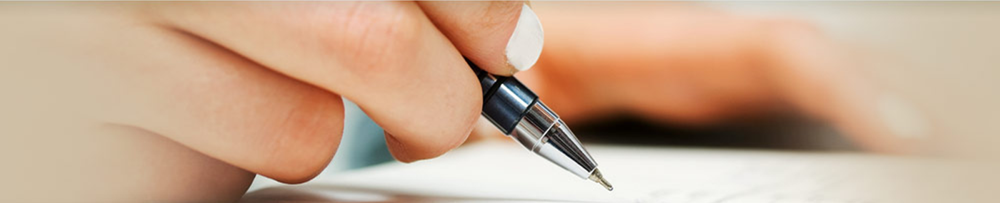 Person writing with pen