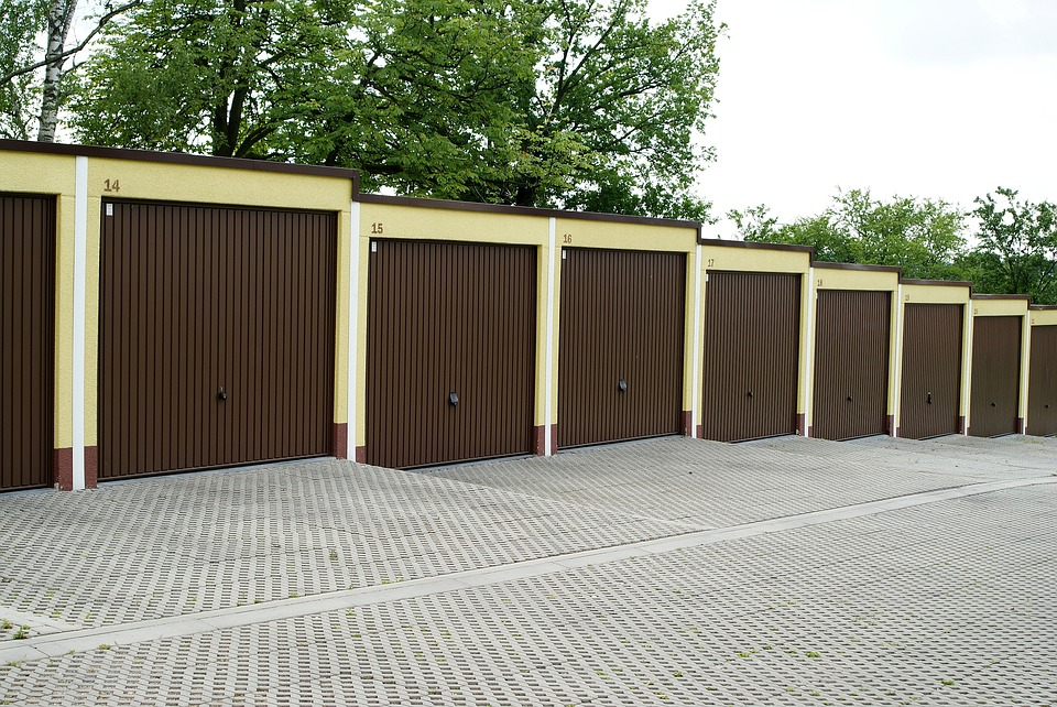 row of concrete garages yellow and brown